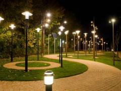 Outdoor lighting poles and armatures